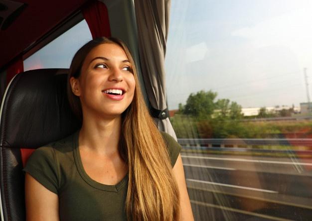 happy cheerful smiling woman enjoying her travel on bus concept public transportation commuter 63239 938 - Побалуй любимую на 8 марта!